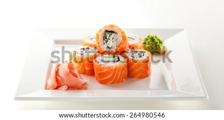 Philadelphia Maki Sushi made of Fresh Raw Salmon, Cream Cheese and Cucumber - stock photo
