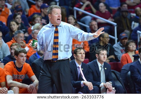 PHILADELPHIA - MARCH 18: Bucknell Bison head coach Dave Paulsen argues a call from the sideline in the NIT first round basketball game March 18, 2015 in Philadelphia. - stock photo