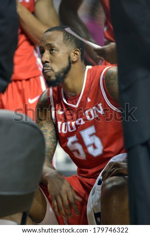 PHILADELPHIA - MARCH 1: Houston Cougars forward J.J. Richardson (55) listens to his coach in a time-out during the AAC basketball game March 1, 2014 in Philadelphia.  - stock photo