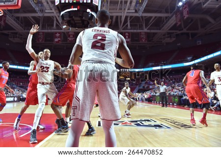PHILADELPHIA - MARCH 25: Temple Owls guard Will Cummings (2) looks to inbounds the ball during the NIT quarterfinal basketball game March 25, 2015 in Philadelphia. - stock photo