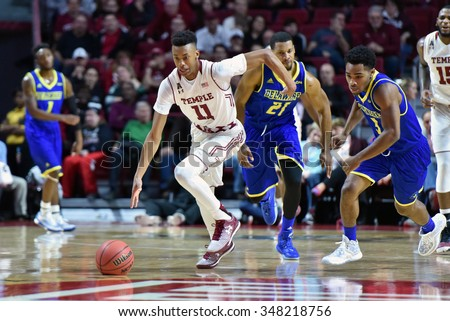 PHILADELPHIA - NOVEMBER 29: Temple Owls guard Trey Lowe (11) breaks away after a steal during a NCAA basketball game November 29, 2015 in Philadelphia.  - stock photo