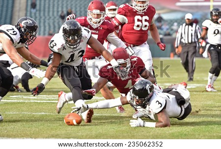 PHILADELPHIA - NOVEMBER 29: Temple Owls running back Kenneth Harper (4) competes with several Bearcats for a loose ball November 29, 2014 in Philadelphia.