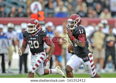 PHILADELPHIA - NOVEMBER 16: Temple quarterback P.J. Walker (11) runs into the open field on a scramble during the AAC college football game November 16, 2013 in Philadelphia.