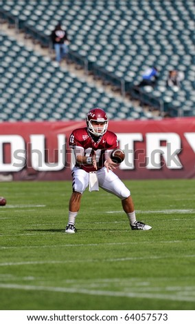 PHILADELPHIA - OCTOBER 30: Temple University quarterback Chris Coyer looks a throw into his hands prior to a game against Akron October 30, 2010 in Philadelphia - stock photo