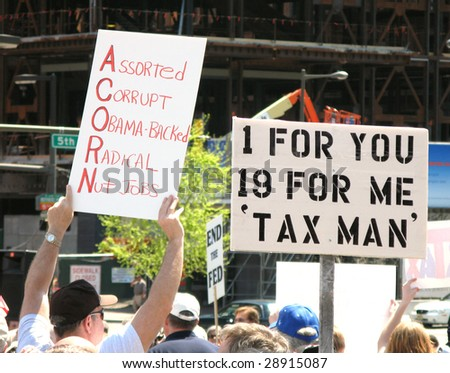 PHILADELPHIA, PA - APRIL 18: Protesters carry placards during tea party protest April 18, 2009 in Philadelphia. The protest is a modern-day protest to the government's spending of billions of dollars. - stock photo