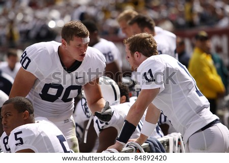 PHILADELPHIA, PA. - SEPTEMBER 17: Penn State Quarterback back Matt McGloin(#11) Andrew Szczerba (#80) talk strategy against Temple September 17, 2011 at Lincoln Financial Field in Philadelphia, PA. - stock photo