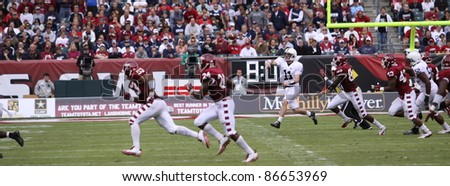 PHILADELPHIA, PA. - SEPTEMBER 17: Penn State quarterbacks Matt McGloin throws a pass during a game with Temple on September 17, 2011 at Lincoln Financial Field in Philadelphia, PA. - stock photo