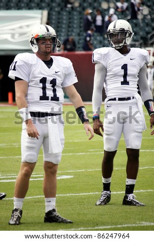 PHILADELPHIA, PA. - SEPTEMBER 17: Penn State Quarterbacks Matthew McGloin and Robert Bolden before a game against Temple on September 17, 2011 at Lincoln Financial Field in Philadelphia, PA. - stock photo