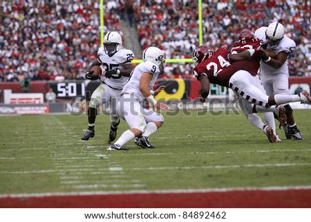 PHILADELPHIA, PA. - SEPTEMBER 17: Penn State running back Silas Redd heads for the end zone, #9 Michael Zorich blocks on September 17, 2011 at Lincoln Financial Field in Philadelphia, PA. - stock photo