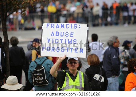 PHILADELPHIA, PA - SEPTEMBER 26 2015: Pope Francis celebrated mass at the Cathedral Basilica of Peter & Paul in downtown Philadelphia. Protester on behalf of abuse victims - stock photo