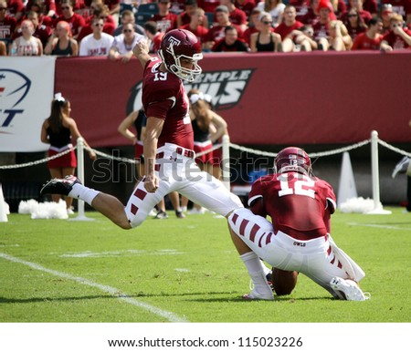 PHILADELPHIA, PA. - SEPTEMBER 8: Temple kicker Brandon McManus kicks an extra point against Maryland on September 8, 2012 at Lincoln Financial Field in Philadelphia, PA. - stock photo