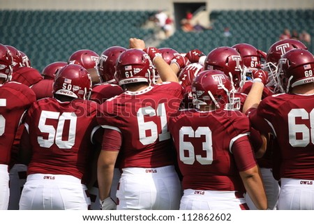 PHILADELPHIA, PA. - SEPTEMBER 8: Temple players huddle before a game against Maryland  on September 8, 2012 at Lincoln Financial Field in Philadelphia, PA. - stock photo