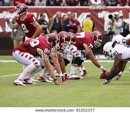 PHILADELPHIA, PA. - SEPTEMBER 17: Temple Quarterback Mike Gerardi changes the play at the liine in  a game against Penn State on September 17, 2011 at Lincoln Financial Field in Philadelphia, PA. - stock photo