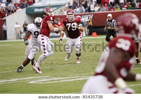 PHILADELPHIA, PA. - SEPTEMBER 17: Temple Quarterback Mike Gerardi is sacked by Penn State's Sean Stanley during a game on September 17, 2011 at Lincoln Financial Field in Philadelphia, PA. - stock photo