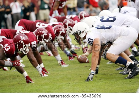 PHILADELPHIA, PA. - SEPTEMBER 17: Temple's Adrian Robinson (No. 43) and the rest of the line look to stop Penn State on September 17, 2011 at Lincoln Financial Field in Philadelphia, PA. - stock photo