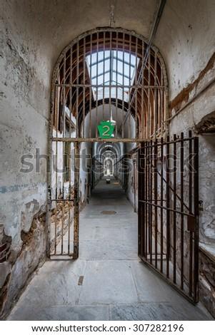PHILADELPHIA, PENNSYLVANIA - JULY 21: Cell block in the Eastern State Penitentiary (1829) on Fairmount Avenue on July 21, 2015 in Philadelphia, Pennsylvania - stock photo