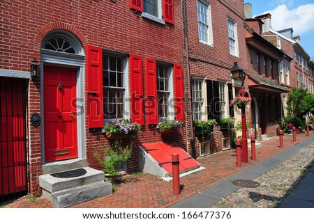 PHILADELPHIA, PENNSYLVANIA:  Superbly preserved colonial-era brick houses dating from 1703-1736 line historic Elfreth's Alley - stock photo
