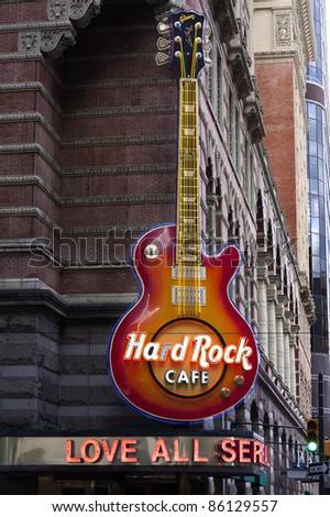 PHILADELPHIA - SEPTEMBER 19: Hard Rock Cafe guitar signage on Sept. 19, 2011 in Philadelphia, PA location. The Hard Rock Cafe has been collecting guitars since Eric Clapton donated his in 1979 - stock photo