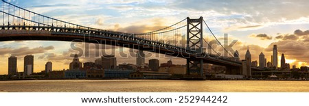 Philadelphia skyline panorama and Ben Franklin Bridge at sunset, USA - stock photo