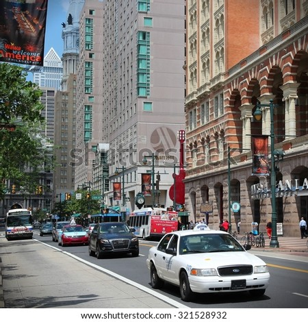 PHILADELPHIA, USA - JUNE 11, 2013: People drive in Philadelphia. As of 2012 Philadelphia is the 5th most populous city in the US with 1,547,607 citizens.