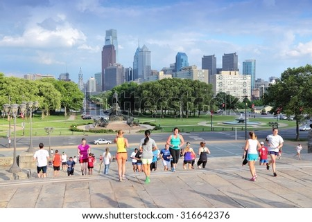 "PHILADELPHIA, USA - JUNE 11, 2013: People run down famous Rocky Steps in Philadelphia. The steps were made famous by the film ""Rocky"" and are known among runners of the world. - stock photo"