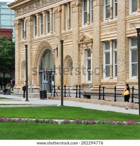 PHILADELPHIA, USA - JUNE 11, 2013: Students walk past Drexel University building in Philadelphia. The university exists since 1891 and had 25,500 students in 2012. - stock photo