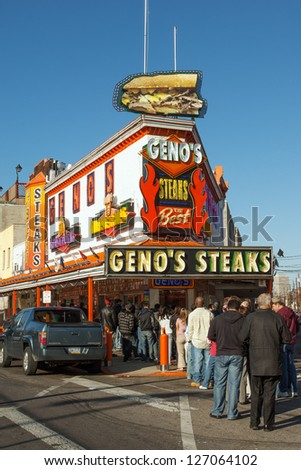PHILADELPHIA, USA - MARCH 3: Line to the famous cheesesteak restaurant Geno's Steaks on March 3, 2008. The restaurant is located in South Philadelphia and serves the most famous Philadelphia dish. - stock photo