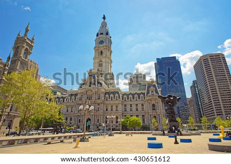 Philadelphia, USA - May 4, 2015: Square near Philadelphia City Hall with sculptures such as Government of the people sculpture. Tourists, Philadelphia City Hall and Church on the background - stock photo