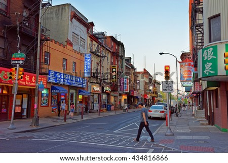 Philadelphia, USA - May 5, 2015: Street view in Chinatown in Philadelphia of Pennsylvania, the USA. Tourist crossing in the street