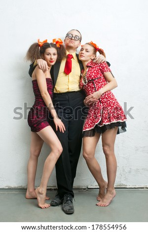 philanderer with two charming girlfriends - stock photo