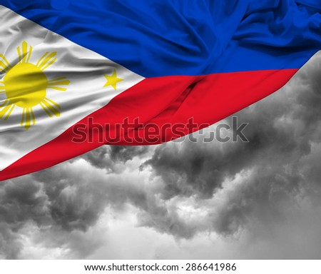 Philippine waving flag on a bad day - stock photo