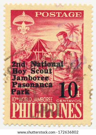 PHILIPPINES - CIRCA 1959: A stamp printed in Philippines, shows Boy Scout, 2nd National Boy Scout Jamboree Pasonanca Park and New Value in Black or Red, circa 1959 - stock photo