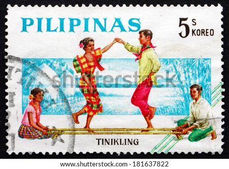 PHILIPPINES - CIRCA 1963: a stamp printed in Philippines shows Tinikling, Bamboo Dance, Folk Dance, circa 1963 - stock photo
