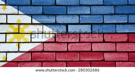 Philippines flag painted on old brick wall texture background - stock photo