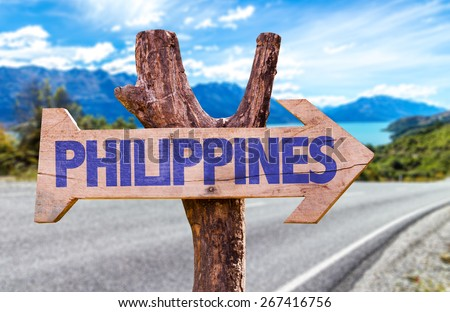 Philippines wooden sign with road background - stock photo