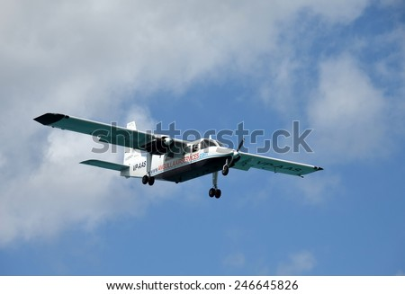 PHILIPSBURG - DECEMBER 24: Anguilla Air Services turboprop airplane arrives in Philipsburg, Saint Maarten in the Caribbean. The airline connects the small island with neighboring airports. - stock photo