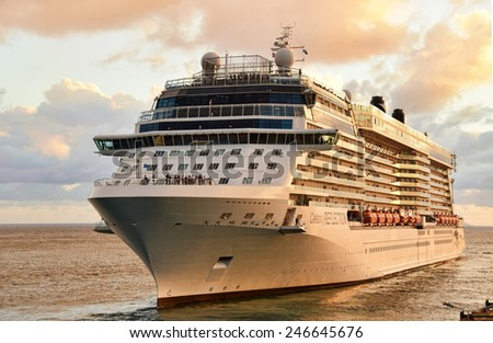 PHILIPSBURG - DECEMBER 24: Celebrity Reflection leaves the Caribbean port of Philipsburg Saint Maarten after a day long visit on December 24, 2014. it is a popular cruise destination. - stock photo