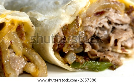 philly cheese steak wrap sandwich with onions peppers - stock photo