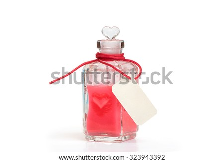 philtre. Glass bottle with love potion. Isolated on white - stock photo