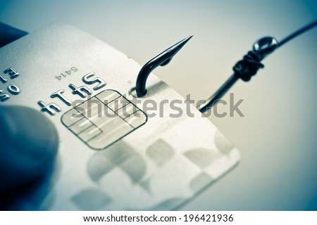 phishing - fish hook and credit card - stock photo