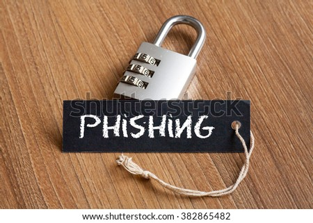 Phishing word written on tag label with combination padlock - stock photo