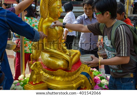 PHITSANULOK,THAILAND - APRIL 6, 2016 Wat Phra Sri Rattana Mahathat Temple celebrates Songkran by pouring water on Buddha images and asking for blessings on April 6, 2016 in phitsnulok,Thailand. - stock photo