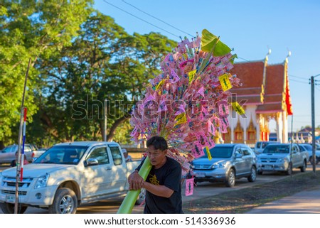 PHITSANULOK, THAILAND - NOVEMBER 12 , 2016 :  people donate Money tree at a Buddhist temple in Phitsanulok, Thailand