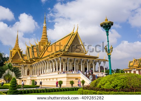 Phnom Penh, Cambodia, 17 Nov 2015: Tourists visiting the Royal Palace in the capital on a sunny day. - stock photo