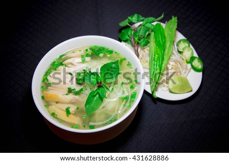 Pho ga or Vietnamese rice noodle soup with sliced chicken - stock photo