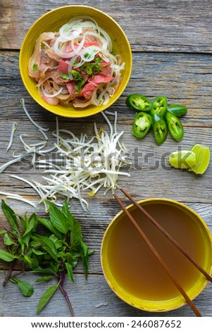 Pho Vietnamese beef soup on a wooden background - stock photo