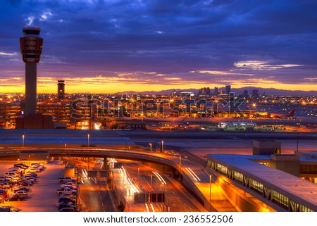 Phoenix airport at sunset with light trails in the street. - stock photo