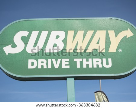 Phoenix, Arizona / USA - January 16, 2016: Subway logo on a street pylon. Subway is an American fast food restaurant franchise that primarily sells submarine sandwiches and salads  - stock photo