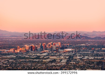 Phoenix Arizona with its downtown lit by the last rays of sun at the dusk. - stock photo