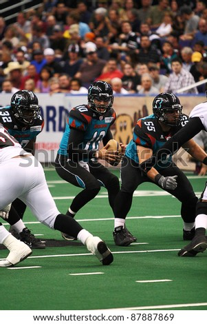 PHOENIX, AZ - APRIL 2: Arizona Rattlers QB Nick Davila (10) drops back to pass during Arena Football League action against the Orlando Predators at U.S. Airways Center on April 2, 2011 in Phoenix AZ.